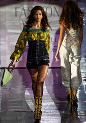 Models present creations from Indian designer Kumar's collection in Lakme Fashion Week in Mumbai