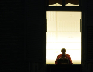 Pope Benedict appears at the window of his private apartments during a special mass at the Vatican