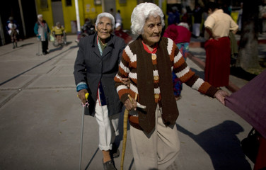 Two blind women walk at Villa Mujeres shelter in Mexico City