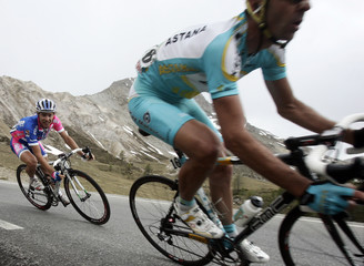 Italian rider Cunego competes during the 12th stage of Giro d'Italia in Briancon
