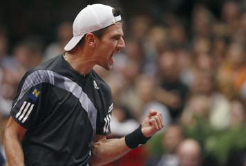 Melzer of Austria reacts to a point during his Vienna Open first round tennis match against Chiudinelli of Switzerland in Vienna