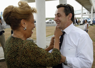France's UMP political party presidential candidate Sarkozy speaks with Guadeloupe Member of Parliament Michaud-Chevry on the tarmac of Pointe-a-Pitre airport