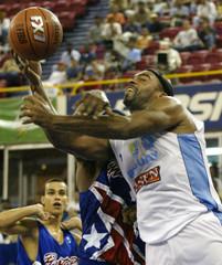 URAGUAYS OWENS HAS BALL KNOCKED AWAY BY PEURTO RICOS RIVERA.