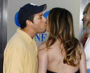 """Actor Sandler kisses wife at premiere of new film """"Click"""" in Los Angeles"""