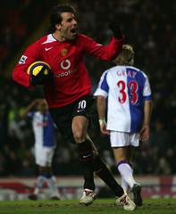 Manchester United's van Nistelrooy celebrates after scoring as Blackburn Rovers' Gray reacts in Blackburn