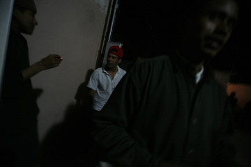 Migrants from Honduras chat after dinner at Catholic-run migrant shelter in Nuevo Laredo