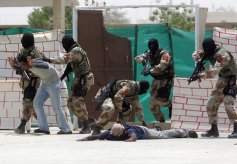 Members of Pakistan Ranger's Anti Terrorist Force exhibit their skills during a demonstration in Karachi