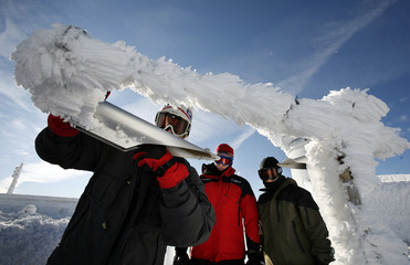 Observer Jim Salge cleans away built-up ice that was disabling a visiometer at the Mount Washington Observatory