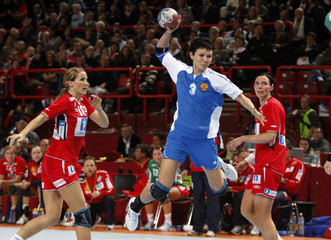 Russia's Poltoratskaya prepares to shoot in final of the women's world handball championship at Bercy in Paris