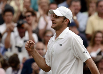 Andy Roddick of the US celebrates winning at the Wimbledon tennis championships.
