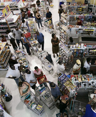 Residents buy supplies in preparation for the arrival of hurricane Dean at a supermarket in Kingston, Jamaica