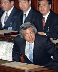 Japan's Prime Minister Junichiro Koizumi leaves the Lower House plenery session in Tokyo.
