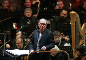 Italian composer Ennio Morricone performs during medal ceremony at the Winter Olympic Games