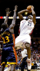 Cavaliers James makes a jump shot over Warriors Richardson in Cleveland, Ohio