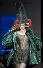 A model presents a creation by Kazakhstan's Kenje design house during Kazakhstan Fashion Week in Almaty