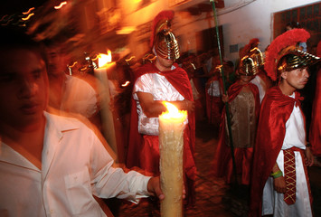 Residents dressed as Roman soldiers walk during a Good Thursday procession  during a procession in Taxco