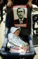 TODDLER SLEEPS DURING ANTI-GLOBALIZATION MARCH IN MONTREAL.