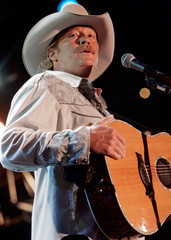 Country artist Alan Jackson plays at the Coliseum at the CMA fan festival in Nashville, Tennesee.
