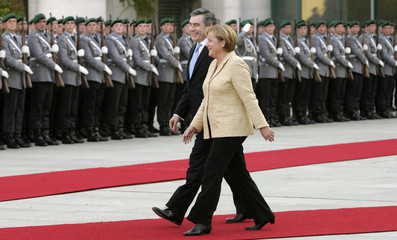 Britain's PM Brown and German Chancellor Merkel review a German armed forces Bundeswehr guard of honour upon Brown's arrival at the chancellery for bilateral talks in Berlin
