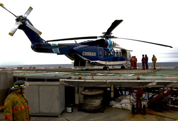 A Cougar Helicopters Sikorsky S-92 helicopter is seen on the helideck of an offshore oil rig on the Grand Banks of Newfoundland in this undated file picture