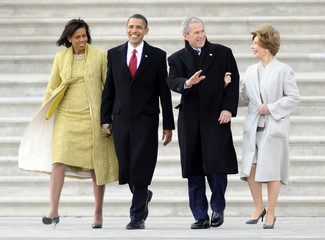 Former President Bush and wife Laura with President Obama with first lady Michelle walk out of the U.S. Capitol  in Washington