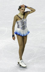 Kostner reacts after women's short program during Figure Skating competition at the Winter Olympic Games