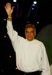 SRI LANKAN PM WAVES TO SUPPORTERS IN COLOMBO.