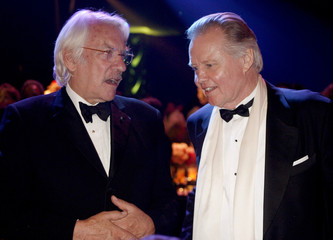 Actors Donald Sutherland and Jon Voight talk during the Governor's Ball after the 58th annual Primetime Emmy Awards in Los Angeles