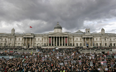 """Protesters stand in Trafalgar Square after the """"No Trident, Troops Out of Iraq"""" demonstration in London"""
