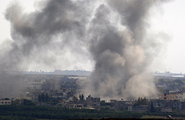 Smoke rises after an Israeli bomb exploded in Beit Lahiya