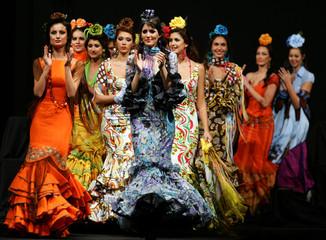 Models present creations from De la feria al Rocio during International Flamenco Fashion Show in Seville