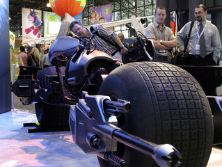"""Exhibitors look at the Batcycle, called the Batpod in the film, for the upcoming movie """"The Dark Knight"""" in New York"""