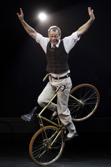 """Comedian on the bicycle"" Serge Huercio of France performs during the 4th International Circus Festival in Moscow"
