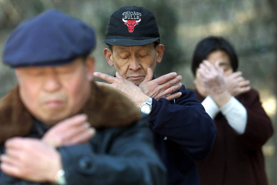 A group of elderly Chinese practice Zhineng Gong, a type of meditation exercise resembling that of t..