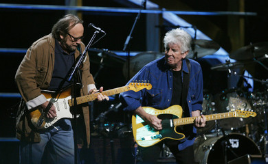 Graham Nash and Stephen Stills perform during the first of two 25th Anniversary Rock & Roll Hall of Fame concerts in New York