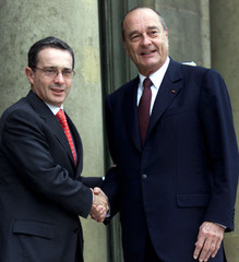 French President Jacques Chirac greets Colombian President Uribe Velez at the Elysee palace, July 2,..