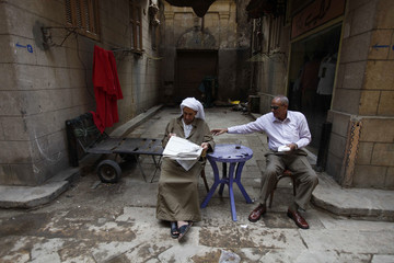 Egyptian men sit at the cafe in the old city in Cairo