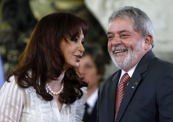 Argentina's President Fernandez talks with her Brazilian counterpart Luiz Inacio Lula da Silva in Buenos Aires
