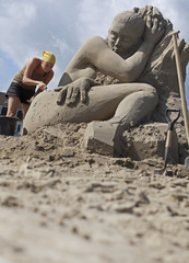 An artist works on a sand sculpture at the Sand Sculptures Festival in Rorschach