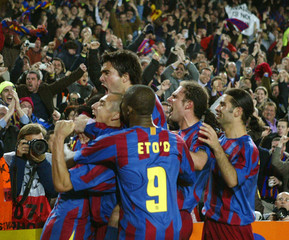 Barcelona's players celebrate goal against Chelsea during Champions League match at Nou Camp Stadium