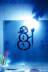 Snowman on the bathroom mirro. Drawing on Mirror.