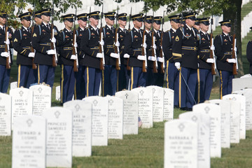 Members of U.S. Army?s 3rd U.S. Infantry Regiment stand at attention inside Section 60 after escorting casket at Arlington National Cemetery