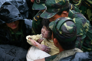 A child is rescued in the earthquake-affected Beichuan county