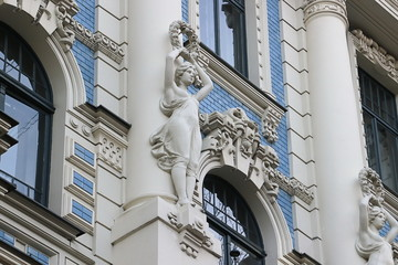 Wall Mural - Facade of old building with sculptures - woman in Art Nouveau style Jugendstil