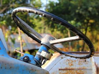 Old steering wheel farm tractor