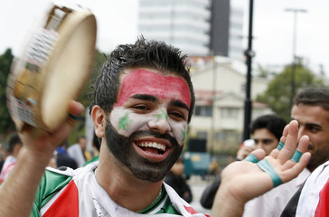 An Iraq fan smiles before the start of the 2010 soccer world cup qualifying match between Australia and Iraq in Brisbane