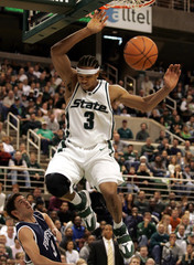 Michigan State's Brown dunks ball over Penn State's Luber during their NCAA game in East Lansing