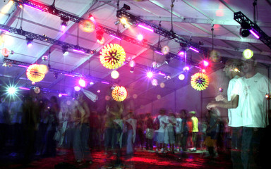 People dance during a rave party at Skolbeats Festival in Brazil.
