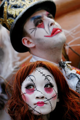 Artists dressed as Scary Doll and Circus Freak pose at Hong Kong's Ocean Park ahead of Halloween event.