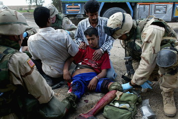 AN INJURED IRAQI BOY RECEIVES MEDICAL ATTENTION BY US SOLDIERS AFTERSTEPPING ON AN EXPLOSIVE DEVICE ...